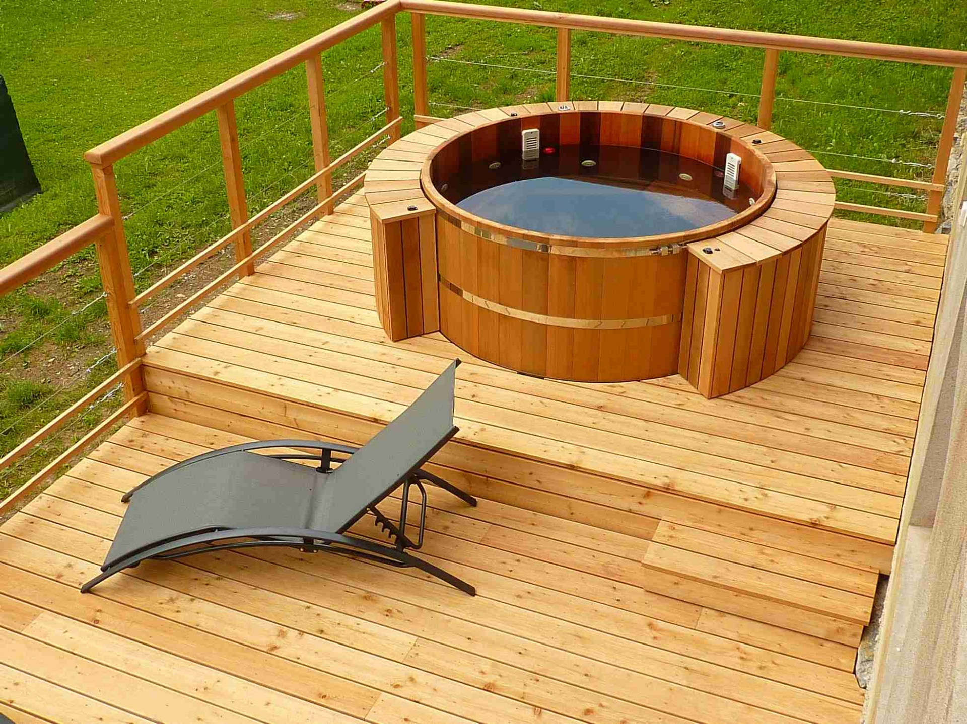 Wooden hot tub low deck high integrated